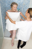 Care giver or nurse  assisting elderly woman for shower. Care giver or nurse  assisting elderly women for shower at home or retirement house Stock Images