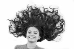 Care that gives healthy beautiful hair. Girl cute child with long curly hair isolated on white. Hair mask recipe royalty free stock photo