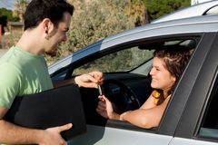 Care hire, rental or new. Passing key to new, hire, or rental car Stock Image