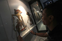 Care of historical objects. Officers perform maintenance of artifacts in the Radya Pustaka museum in Solo, Central Java, Indonesia. This historical object is a Stock Photos