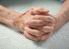 Care is at home of elderly. Old people holding hands. Stock Images