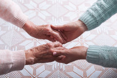 Care is at home of elderly. Senior woman with their caregiver at home. Concept of health care for elderly old people Royalty Free Stock Photography