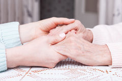 Care is at home of elderly. Space for text. Senior woman with their caregiver at home. Concept of health care for Royalty Free Stock Photography