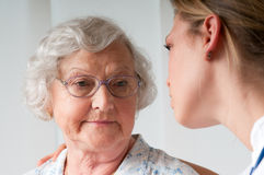 Care at hospital. Sad and lonely senior women with nurse Royalty Free Stock Photos