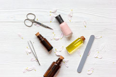 Care of nails and cuticle on wooden background top view.  Stock Images