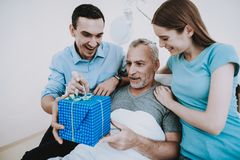 Care about Old Man in Hospital. Gift For Old Man. Royalty Free Stock Photo