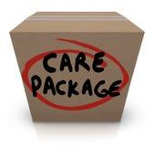 Care-Paket-Pappschachtel-Wort-Stützsoforthilfe Stockfotos