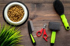 Care about pet with brushes and grooming equipment on wooden background top view Royalty Free Stock Photography