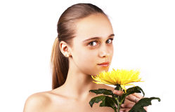 Care portrait of pretty woman holding flower Royalty Free Stock Image