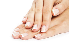 Care for sensuality woman nails. Isolated on a white background Royalty Free Stock Image