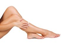 Care of a skin. Two woman legs with moisturizer body cream Royalty Free Stock Photography