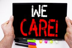 We Care text written on tablet, computer in the office with marker, pen, stationery. Business concept for Career Assistance Helpli Royalty Free Stock Images
