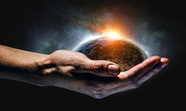 With care to our planet Stock Photos