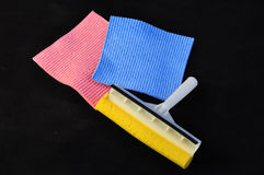 Care tools. Colorful sponges and washer white and yellow on black background royalty free stock images