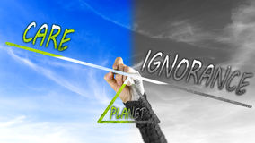 Care versus ignorance over our planet. Care versus ignorance on a scale over our planet Stock Photos