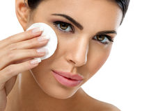 Care woman removing face makeup with cotton pad. Skin care woman removing face makeup with cotton swab pad - skin care concept Stock Image