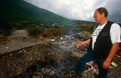 A CARE worker in a destroyed village in Kosovo. Royalty Free Stock Images