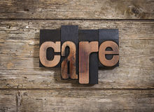Care written with letterpress type Stock Image