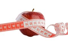 Care your figure and your health. One red apple with tape Stock Image