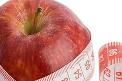 Care your figure and your health. One red apple with tape Royalty Free Stock Photos