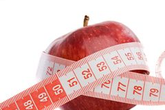 Care your figure and your health. One red apple with tape Stock Photos