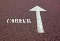 Career. Written near a white arrow on asphalt showing the direction to find a job Royalty Free Stock Photography