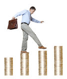 Career. Businessman with briefcase walking money upstairs Royalty Free Stock Images