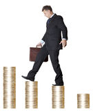 Career. Businessman with briefcase walking money upstairs Stock Image