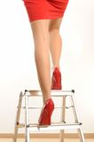 Career. Woman on a ladder, symbol for career Stock Photos