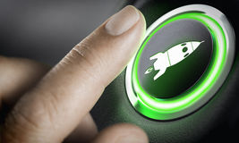 Career Accelerator, Boost Button. Man finger pressing an boost button with a rocket icon, black background and green light. Composite between a photography and a Stock Photos