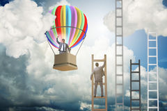 Career achievement concept with businessman on balloon and ladde. R Royalty Free Stock Photos