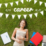 Career against pretty student lying on grass Stock Photos