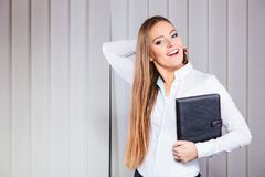 Young woman office worker hold case with files. Stock Photography