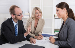 Career and candidate: three people sitting in a job interview fo Stock Photos