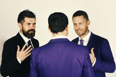 Career and competition concept. Men with beard and persuasive faces discuss business. CEOs have dispute and meeting on. Light grey background. Businessmen wear stock photography