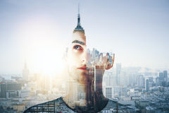 Career concept. Abstract portrait of thoughtful handsome young guy on city background with tower and sunlight. Career concept. Double exposure Stock Photos