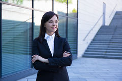 Career concept - beautiful business woman over modern city backg Stock Image