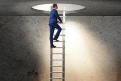 The career concept with businessman climbing ladder Stock Photo