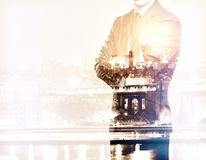 Career concept. Businessman with folded arms on city background. Double exposure. Career concept Stock Photography