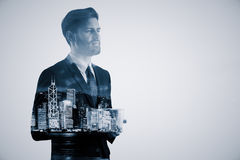 Career concept. Handsome thoughtful young businessman drinking coffee on abstract night city background. Career concept. Double exposure Stock Photo