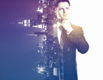 Career concept. Handsome young businessman on city background. Double exposure. Career concept Stock Photography