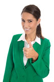 Career concept: isolated businesswoman in green making thumb up Royalty Free Stock Image