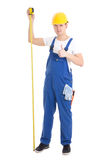 Career concept - man builder in blue uniform holding measure tap Royalty Free Stock Photos