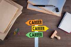 Career concept. Paper signpost on a wooden desk.  Stock Photo