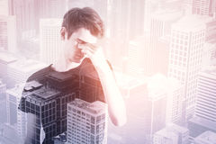 Career concept. Portrait of thoughtful handsome young man on city background with copy space. Career concept Royalty Free Stock Photo