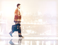 Career concept. Side view of walking businessman on city background. Double exposure. Career concept Royalty Free Stock Photo