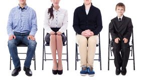 Career concept - young business people and one little boy sitting on office chairs isolated on white. Background stock photos