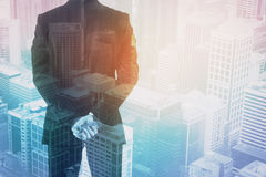 Career concept. Young businessman on city background. Career concept. Double exposure Royalty Free Stock Photos