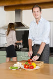 Career couple in kitchen stock photos