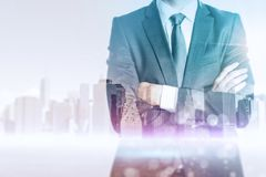 Career development and employment concept. Businessman on abstract city background with copy space. Career development and employment concept. Double exposure Stock Photography